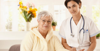 nurse and old woman at the living room